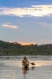Indigenous People Cuyabeno Ecuador National Park. Indigenous Adult Man With Canoe On Laguna Grande Cuyabeno National Park Ecuador At Sunset Model Released Stock Image