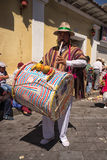 Indigenous quechua male drumming in the street Royalty Free Stock Images