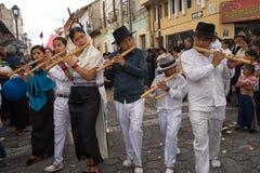 Indigenous quechua playing flutes atEaster procession. April 14, 2017 Cotacachi, Ecuador: indigenous quechua playing flute made of bamboo at the Easter Stock Photo