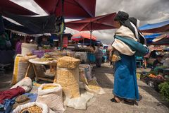 Indigenous quechua woman dressed traditionally in Otavalo Ecuador farmers market Royalty Free Stock Photo