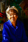 Indigenous senior woman in light and shadow Royalty Free Stock Photo