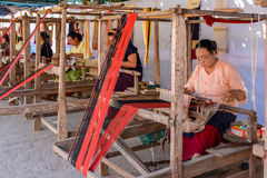 Indigenous senior women are weaving fabric Stock Photo