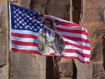 Indigenous States of America. American flag with Indian figure flying in Monument Valley Tribal Park Stock Image