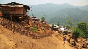 Indigenous tribal culture of Akha tribe village,Pongsali,Laos stock video footage