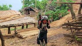 Indigenous tribal native Akha woman carry water in bamboo stick stock video footage
