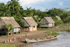 Indigenous Village and Boat Stock Image