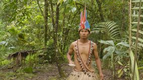 Indigenous Warrior Following The Viewer In The Amazon Jungle