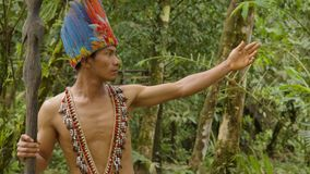 Indigenous Warrior Showing The Viewer The Amazon Rainforest