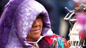 Indigenous woman wears a purple scarf in her head. Chiapas, Mexico-Circa August 2018 (close up): Indigenous woman wears a purple scarf in her head in San stock video footage