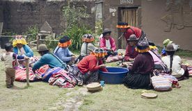 Indigenous women cutting potatoes for a local wedding ceremony. Stock Photos