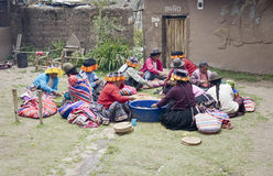 Indigenous women cutting potatoes for a local wedding ceremony stock images