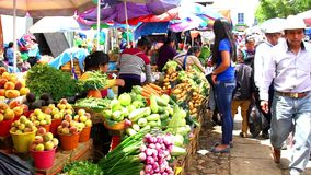 Indigenous women offering and selling vegetables. Chiapas, Mexico - circa August 2018: Indigenous women offering and selling a wide variety of vegetables in the stock footage