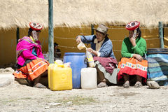 Indigenous women selling chicha fermented corn beer at the market Royalty Free Stock Image