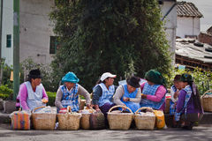Indigenous women selling street food in Cayambe Stock Photos