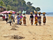 Indigenous women in traditional clothes hampers with their heads, Nosy Be, Madagascar Royalty Free Stock Photos