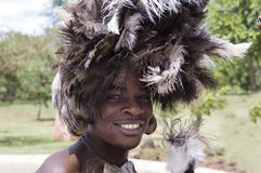 Indigenous Dancer in Africa. Indigenous young dancer with feather decoration in zambia Royalty Free Stock Image