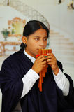 Indigenous young man from Otavalo, Ecuador, playing the rondador Stock Photo