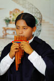 Indigenous young man from Otavalo, Ecuador, playing the rondador Stock Photography