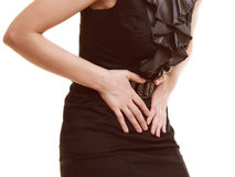 Indigestion. Closeup of woman suffering from stomach pain. Bellyache, indigestion or menstruation. Closeup of woman girl suffering from stomach pain isolated on Royalty Free Stock Image