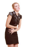 indigestion Femme souffrant de la douleur abdominale d'isolement Image stock
