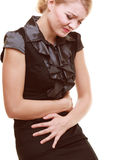 Indigestion. Woman suffering from stomach pain isolated. Royalty Free Stock Images