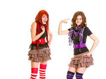 Indignant girl and her girlfriend showing crazy. Indignant girl with hand on chest and her girlfriend showing crazy gesture isolated on white Stock Images