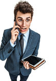 Indignant man talking on mobile phone Stock Photos