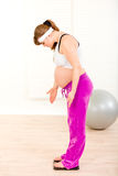 Indignant pregnant woman measuring her weight Stock Photos