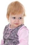 Indignant toddler in pnik Royalty Free Stock Photo