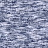 Indigo blue woven boro cotton dyed effect texture background. Seamless japanese repeat batik pattern swatch. Wrinkled