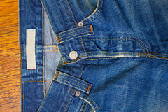 Indigo jeans with a button Stock Photography