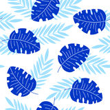 Indigo tropical leaves seamless pattern Stock Photos