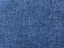 Indigohintergrund mit blauem Denimgewebe lizenzfreies stockfoto