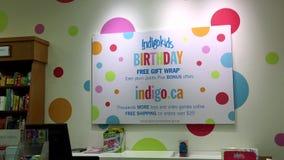 Indigokids birthday free gift wrap sign on wall Royalty Free Stock Photo