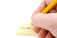 Indirizzo di Web di scrittura su documento Fotografie Stock