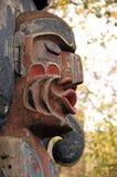 Indisch totempaalgezicht stock afbeeldingen