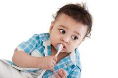 Indische baby het borstelen tanden Stock Afbeelding