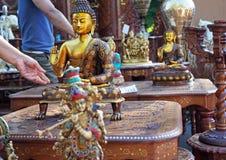 Indische herinneringsbeeldjes van Boedha en Krishna stock fotografie