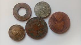 Indische oude muntstukken stock afbeeldingen