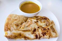Indische Roti Prata met de Saus van de Kerrie Stock Foto's