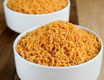 Indische snack-Aloo sev stock foto