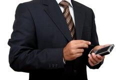 Indischer Geschäftsmann, der pda (1) verwendet Lizenzfreie Stockfotos