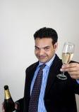 Indischer Geschäftsmann, der zum Erfolg röstet Stockfotografie