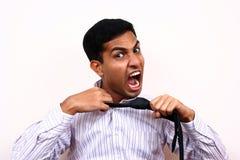 Indischer schreiender Geschäftsmann. Stockbild