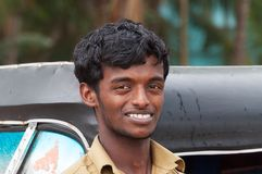 Indischer Taxifahrermann der Selbstrikscha Stockfotografie