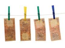 Indisches Geld auf dem Seil Lizenzfreie Stockfotografie