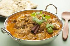 Indisches Mahlzeit-Nahrungsmittelcurry-Lamm Rogan Josh Naan Brot Stockfoto