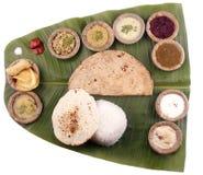 Indisches Südmittagessen auf Bananenblatt + Ausschnittsschablone Lizenzfreie Stockbilder