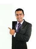 Indisk affärsman som visar det vita plakatet Arkivbild