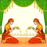Indisk kvinna som välkomnar med blomman Arkivbild